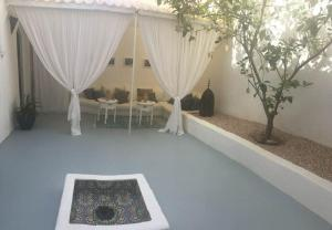 The swimming pool at or near VILLA CHARAF BOUGAINVILLIER