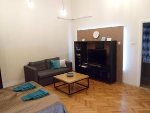 A television and/or entertainment center at Centrál Apartman