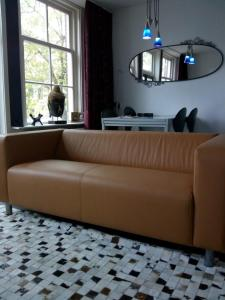 A seating area at Jordaan Canal View Apartment