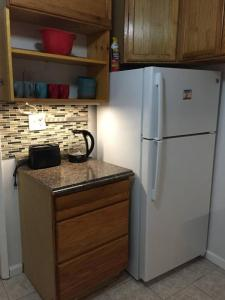 A kitchen or kitchenette at Historic Center & Italian Market 2-Bedroom Apt