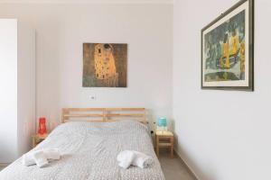 Gulta vai gultas numurā naktsmītnē Hintown Happy Family Villa