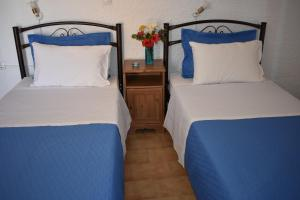 A bed or beds in a room at Eriketi Studios