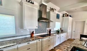 A kitchen or kitchenette at Beach Bunkhouse Home