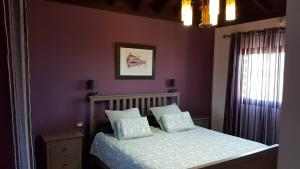 A bed or beds in a room at Villa El Tagoro