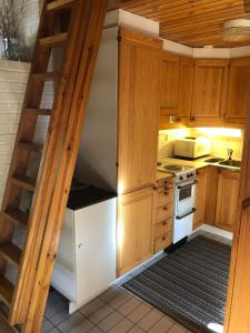 A kitchen or kitchenette at Cottages SAA