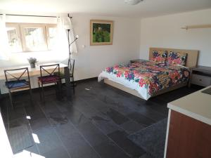 A bed or beds in a room at Appartamento La Castagna