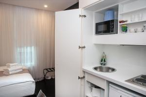 A kitchen or kitchenette at MStay Golders Green