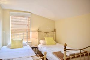 Ein Bett oder Betten in einem Zimmer der Unterkunft 3 Bedroom House by William Clarke Park