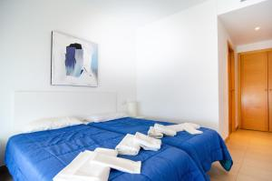A bed or beds in a room at Torre D'Oboe Apartamentos