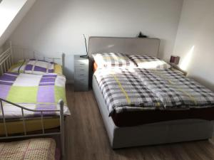 A bed or beds in a room at Cityflair Apartments