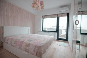 A bed or beds in a room at Aio Boutique Apartments