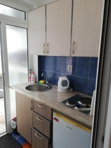 Кухня или мини-кухня в Apartments Familia