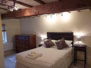 A bed or beds in a room at The Blacksmiths Townhouse City Centre 17th Century