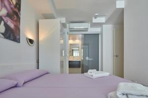 A bed or beds in a room at Apartamentos Centremar