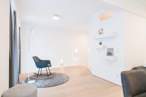 A seating area at Luxus Maisonette Liechtenstein by welcome2vienna
