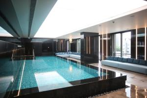 The swimming pool at or near IST FLATS Serviced Apartments-EMAAR SQ