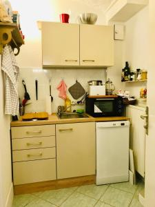 A kitchen or kitchenette at City Hideaway with Terrace