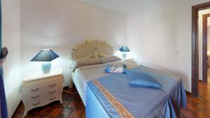 A bed or beds in a room at Villa 4bed private pool en Los Cristianos