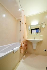 A bathroom at Penelopa Palace Apart Hotel & SPA