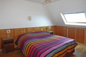 A bed or beds in a room at Holiday Home Perros-Guirec - BRE02690-F