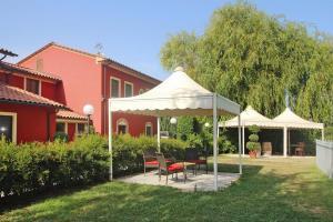 A garden outside Agri-tourism Casolare dei Fiori Montecarlo - ITO041001-DYB