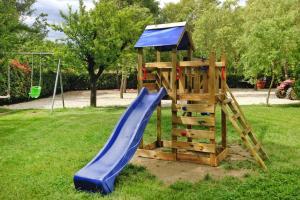 Children's play area at Agri-tourism Casolare dei Fiori Montecarlo - ITO041001-DYB