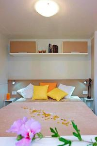 A bed or beds in a room at Holiday resort Fiemme Village Ballamonte di Predazzo - IDO01301-MYC