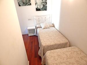A bed or beds in a room at Apartamento Familiar Barrio Antiguo 2.3