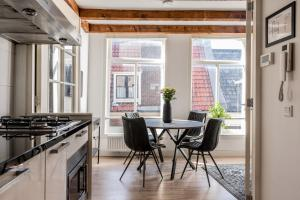 A kitchen or kitchenette at District Apartment