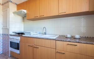 Virtuve vai virtuves aprīkojums naktsmītnē Le Corail Appart'Hotel Yasmine Hammamet