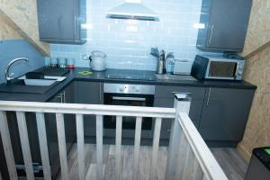A kitchen or kitchenette at Lochanside