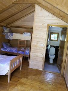 A bunk bed or bunk beds in a room at Villas Jezerca