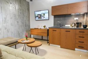 A kitchen or kitchenette at Royal Hotel and Suites