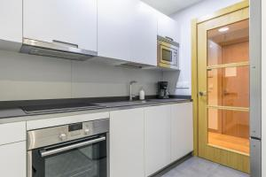 A kitchen or kitchenette at Zurriola Suites by Forever Rentals