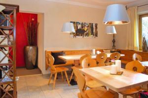 A restaurant or other place to eat at Apartments Landhof Ellmau Ellmau - OTR06502-EYD