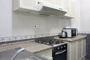 A kitchen or kitchenette at Sahara Hotel Apartments