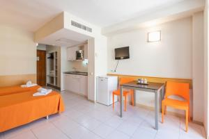 A television and/or entertainment center at Salou Pacific Rentalmar