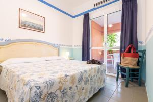A bed or beds in a room at TH Ortano Mare Residence