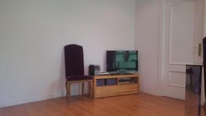 A television and/or entertainment center at Apartment Glorieta Puerta de Toledo