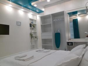Кровать или кровати в номере Domentis