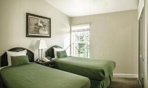 A bed or beds in a room at Parc Corniche Condominium Suites