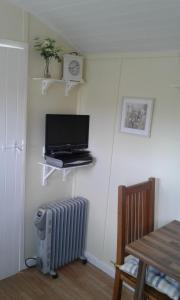 A television and/or entertainment center at The Shepherd's Hut