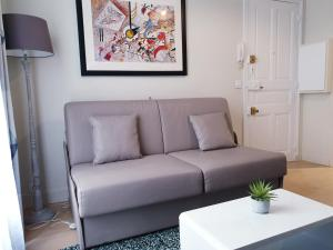 A seating area at Apartment Quartier Latin - Mouffetard