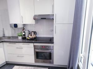 A kitchen or kitchenette at Apartment Quartier Latin - Monge