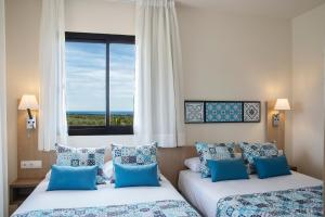 Een bed of bedden in een kamer bij Pierre & Vacances Village Bonavista de Bonmont
