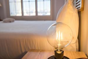 Ein Bett oder Betten in einem Zimmer der Unterkunft Habitat Apartments Bailén