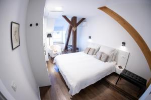 Ein Bett oder Betten in einem Zimmer der Unterkunft Apartment Duplex in Old Town