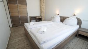 Un ou plusieurs lits dans un hébergement de l'établissement Apartments Lulic