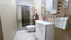 Salle de bains dans l'établissement Apartments Lulic