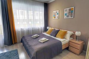 Asbóth Taylor Apartment tesisinde bir odada yatak veya yataklar